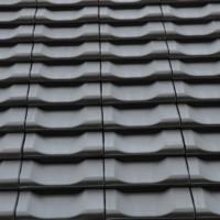 Dacheindeckung mit engobiertem Ziegel Jacobi Z10 in altschwarz