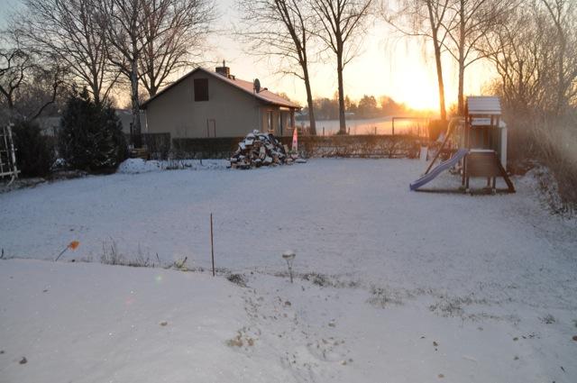 Der Hausbau im Sonnenaufgang