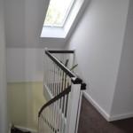Aufgang und Flur - Treppe mit Fenster zum Dachgeschoss