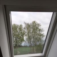 Dachfenster im Obergeschoss: Rollo als Hitzeschutz