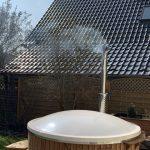 Badefass mit Holz heizen - Holzofen hat Vorteile und Nachteile